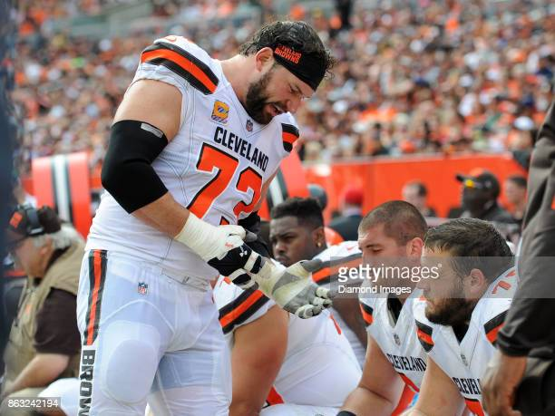 Left tackle Joe Thomas of the Cleveland Browns talks with left guard Joel Bitonio and center JC Tretter on the sideline in the fourth quarter of a...