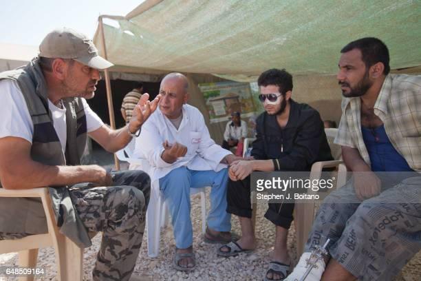 Left to right Abdul Sattar Refaik a Syrian from a Venseulian NGO Dr Gartoum Mohamed a Moroccan Psychiatrist Abdel Ghafour Homsy a former Free Syrian...