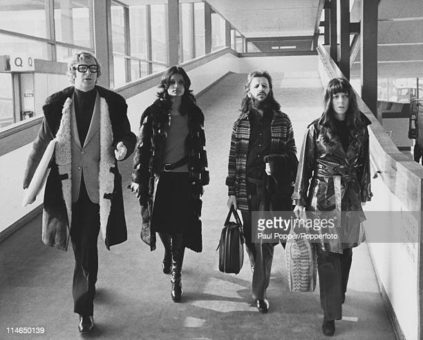 actor Michael Caine his future wife Shakira Baksh former Beatle Ringo Starr and his wife Maureen at Heathrow Airport 28th February 1972 The four are...