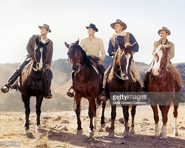 actors Earl Holliman Dean Martin John Wayne and Michael Anderson Jr in the western 'The Sons Of Katie Elder' directed by Henry Hathaway 1965