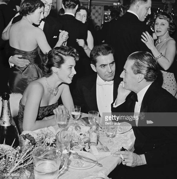 actors Linda Christian her husband Tyrone Power and Ivor Novello meet for a drink at the Cafe de Paris in London February 1951 Original Publication...