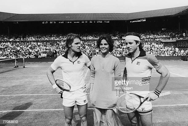 American actor Dean Paul Martin American actress Ali McGraw and tennis Player Guillermo Vilas of Argentina with a crowd of extras on the Centre Court...