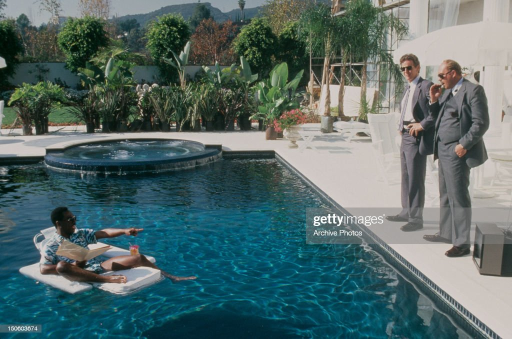 American actors Eddie Murphy Judge Reinhold and John Ashton on the set of 'Beverly Hills Cop II' directed by Tony Scott USA 1987