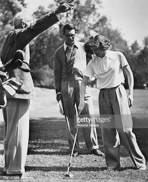 American director Howard Hawks with actors Cary Grant and Katharine Hepburn on the set of 'Bringing Up Baby' 1937