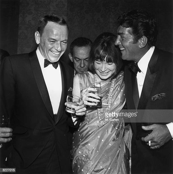 Left to right American singer and actor Frank Sinatra wearing a tuxedo American actor Shirley MacLaine wearing a sari and American singer and actor...