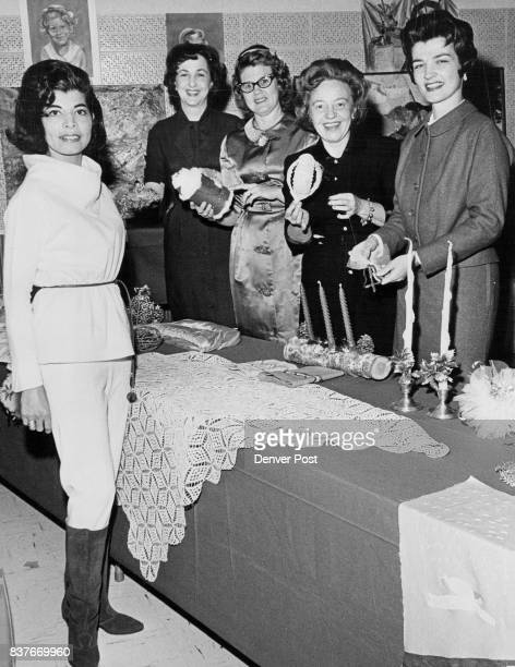 Left to right are Mrs Johnny C Harrod who modeled clothing Mrs Charles B Meurer Mrs William Ringo III president Mrs Patrick Tucker and Mrs Ray Combes...