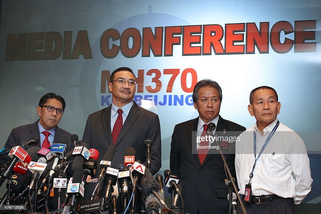 Left to right, Azharuddin Abdul Rahman, director general of Malaysia's Department of Civil Aviation, Hishammuddin Hussein, Malaysia's acting transport minister, <a gi-track='captionPersonalityLinkClicked' href=/galleries/search?phrase=Anifah+Aman&family=editorial&specificpeople=5958202 ng-click='$event.stopPropagation()'>Anifah Aman</a>, Malaysia's minister of foreign affairs and <a gi-track='captionPersonalityLinkClicked' href=/galleries/search?phrase=Ahmad+Jauhari+Yahya&family=editorial&specificpeople=9527900 ng-click='$event.stopPropagation()'>Ahmad Jauhari Yahya</a>, chief executive officer of Malaysian Airline System Bhd. (MAS), answer questions during a news conference in Sepang, Malaysia, on Thursday, March 20, 2014. Aircraft sent to check whether objects spotted by satellite in the southern Indian Ocean belong to the missing Malaysian passenger jet returned without making any sightings, as the search stretched into the 13th day. Photographer: Goh Seng Chong/Bloomberg via Getty Images