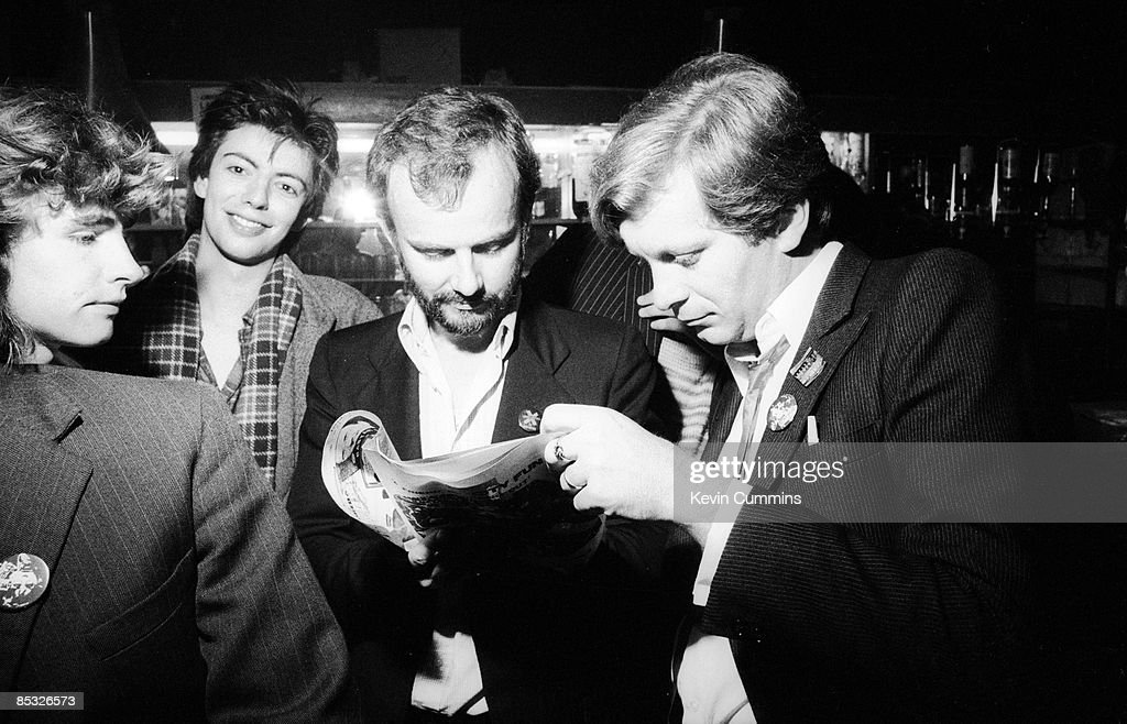 bassist Les Pattinson and singer Ian McCulloch of British band Echo and the Bunnymen, BBC Radio 1 disc jockey John Peel (1939 - 2004) and journalist and co-founder of Factory Records, Tony Wilson (1950 - 2007, right) at the Russell Club, also known as The Factory, Manchester, 20th July 1979.