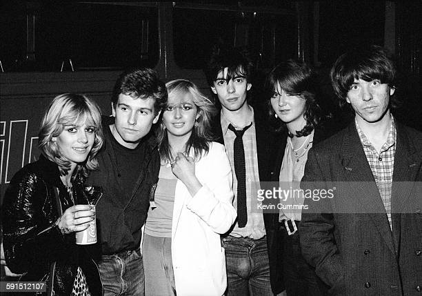 bassist Les Pattinson singer Ian McCulloch and guitarist Will Sergeant of British band Echo and the Bunnymen with female friends circa 1979