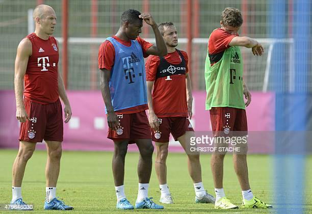 Left to right Bayern Munich's Dutch midfielder Arjen Robben Austrian defender David Alaba Brazilian defender Rafinha and striker Thomas Mueller takes...
