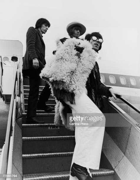 Bill Wyman Brian Jones and Keith Richards board a transatlantic flight from London Airport 12th January 1967