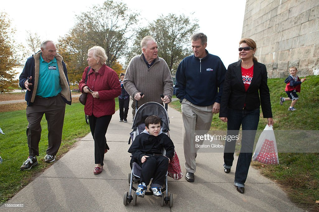 Left to right, Billy Higgins, Kathy Flynn, former Mayor Ray Flynn, Braedan O'Doherty, 6, Senator Scott Brown, and Gail Huff walk up to the Magical Halloween Castle on Castle Island on October 27, 2012.