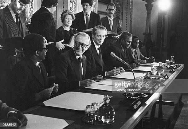Left to right Bishop Abel Mizarewa Lord Peter Carrington Sir Ian Gilmour Joshua Nkomo and Robert Mugabe at the signing ceremony of the AngloZimbabwe...