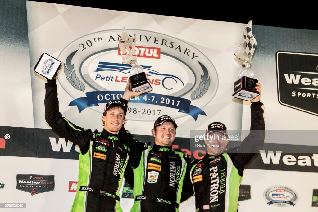 Left to right, Brendan Hartley, of New Zealand, Ryan Dalziel, and Scott Sharp celebrate in victory lane after winning the Motul Petit Le Mans at Road Atlanta on October 7, 2017 in Braselton, Georgia.