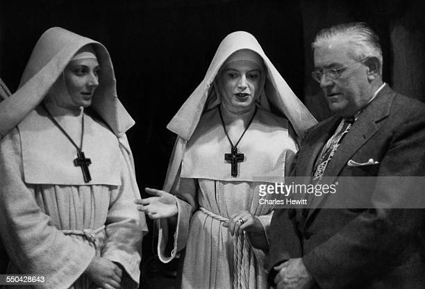 British actresses Kathleen Byron and Deborah Kerr with American film censor Joseph Breen on the set of 'Black Narcissus' directed by Michael Powell...