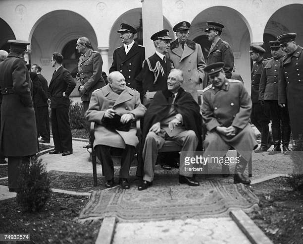 British Prime Minister Winston Churchill US President Franklin Delano Roosevelt and Soviet leader Joseph Stalin in the grounds of the Livadia Palace...