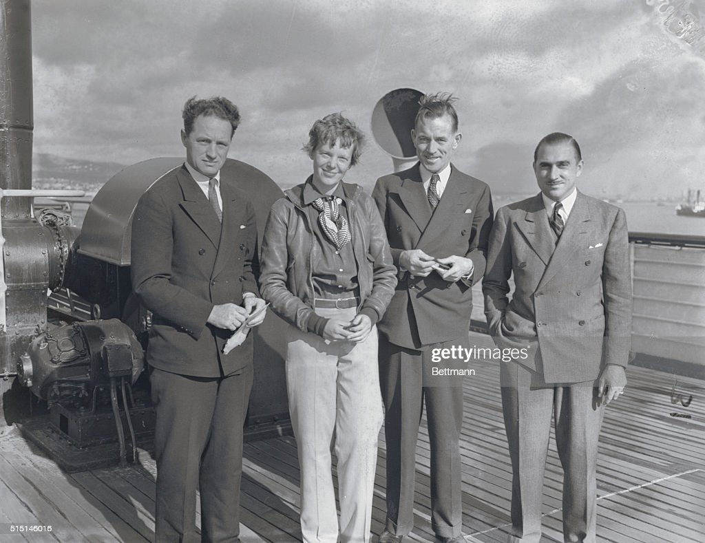 Left to right Captain Harry Manning, Amelia Earhart, Fred Noonan, co-navigator, and Paul Mantz, as they arrived in Los Angeles, California, aboard the S. S. Malolo from Honolulu, Hawaii.