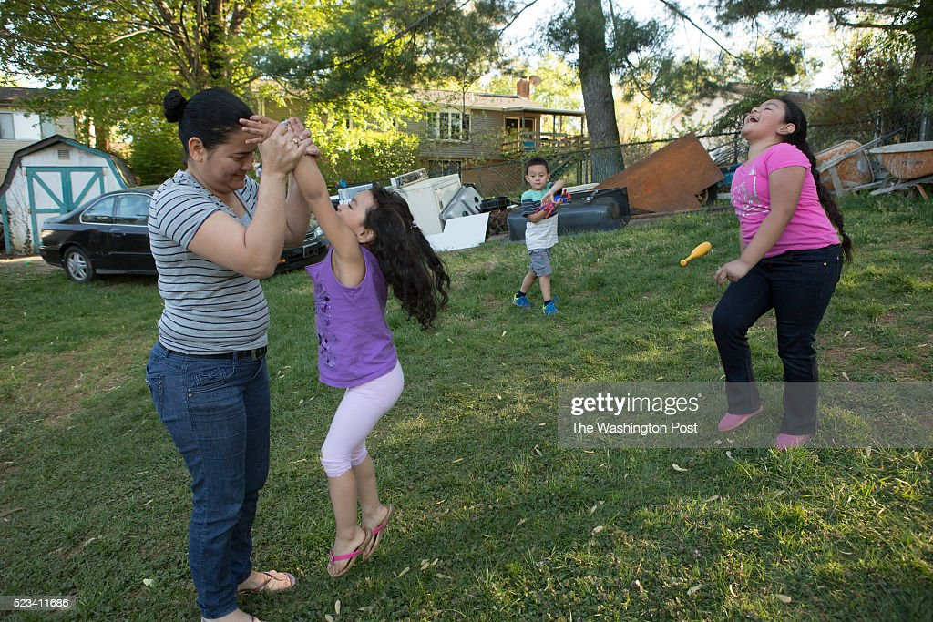 Left to right Catia Paz plays with her daughter Alison Reyes Paz nephew Daniel Moeno and daughter Genesis Reyes Paz at their home in Woodbridge VA...