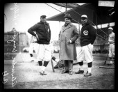 Chicago Cubs baseball player Alexander coowner William Wrigley Jr and manager Bill Killefer standing behind a batting practice backstop on the field...