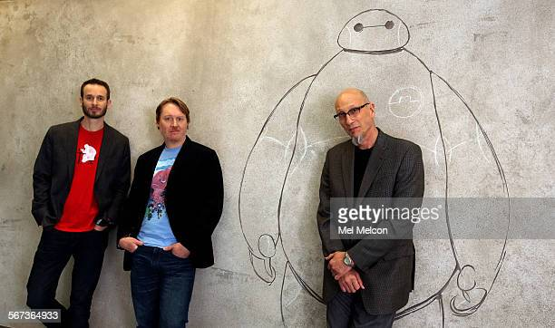 Left to right Chris Williams and Don Hall codirectors for the Disney animated film Big Hero 6 and Roy Conli the movie's producer are photographed on...