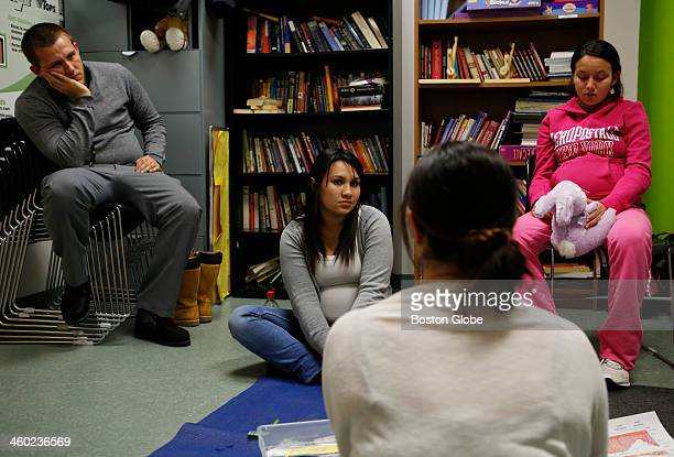 Left to right Christopher Rivera of Chelsea sits beside his partner Jessica Contreras of Chelsea and Marie Lopera of Revere as the three listen to...