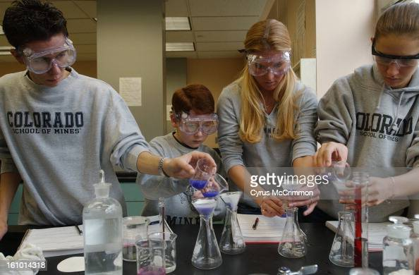 Colorado School of Mines freshmen students Kyle Sanoval Dylan Jones 10 yearsold Cristin Cammon and Amanda Savage work together during a Chemistry 101...