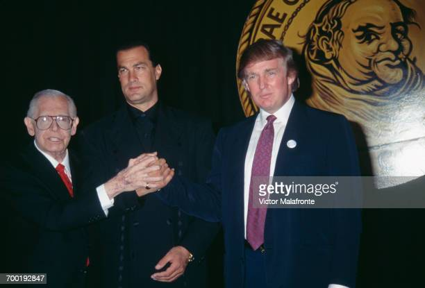comedian Milton Berle actor Steven Seagal and American real estate magnate Donald Trump at a Friar's Club roast for Seagal New York City 6th October...