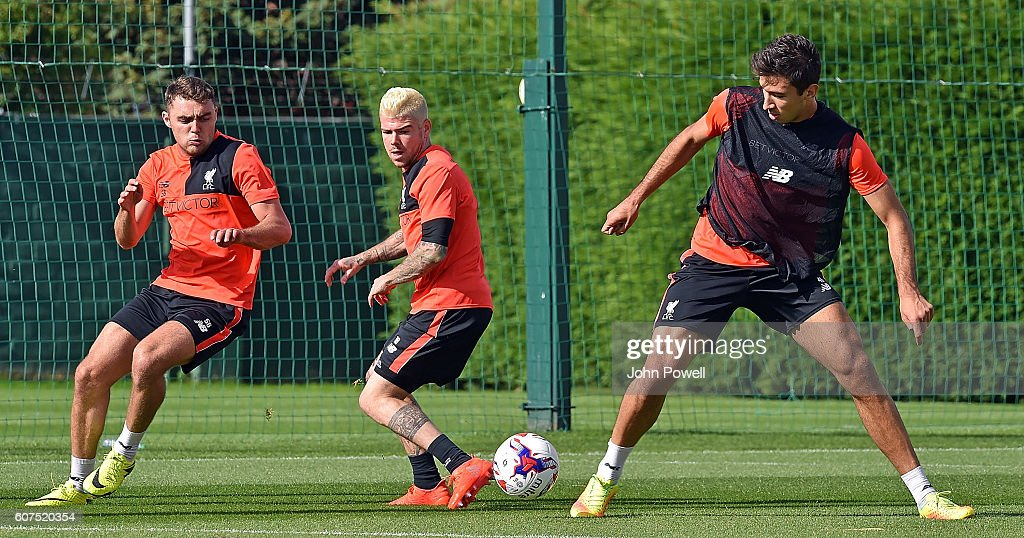 Left to Right Conner Randall Alberto Moreno and Marko Grujic of Liverpool during a training session at Melwood Training Ground on September 18, 2016 in Liverpool, England.