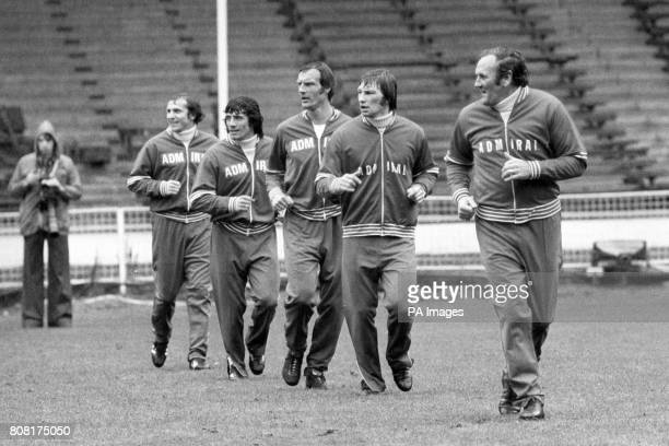 Left to right Dennis Tueart Kevin Keegan Paul Madeley Colin Todd and England manager Don Revie training at Wembley Stadium