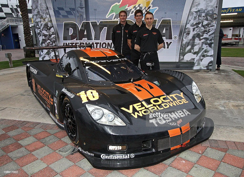 Left to right, drivers Ryan Hunter-Reay, Jordan Taylor and Max Angelelli pose with the #10 Wayne Taylor Racing Velocity Worldwide Corvette Dallara DP after a press conference announcing Velocity Worldwide as the team's new sponsor at Daytona International Speedway on January 3, 2013 in Daytona Beach, Florida.