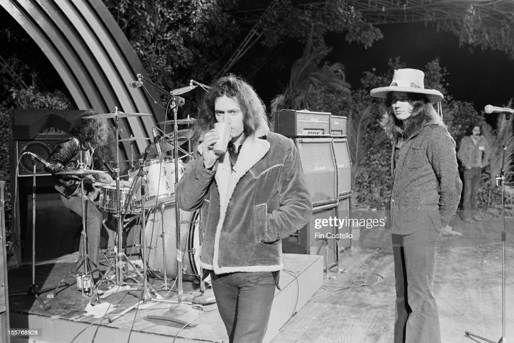 drummer Ian Paice, guitarist Ritchie Blackmore and singer David Coverdale, of English rock group Deep Purple, on the stage at the Ontario Motor Speedway, Ontario, California, before their performance at the California Jam rock festival, 6th April 1974.