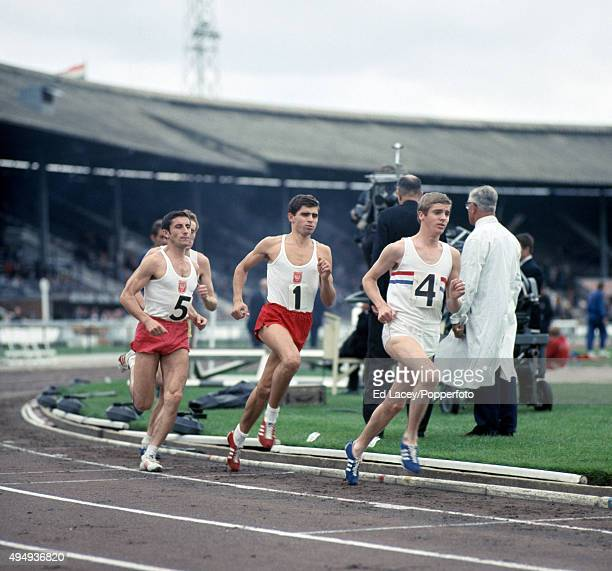 Edward Stawiarz and Roland Brehmer of Poland and Alan Rushmer of Great Britain in the mens 5000 metres event during an athletics meet at White City...