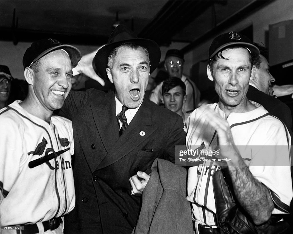 - Left to Right -Enos Slaughter, Ford Frick, and Harry Brecheen, pose for the camera while celebrating in the Cardinals locker room after thier game 7 World Series win over the Boston Red Sox, in St. Louis, Missouri at Sportsman's Park, on October 15, 1946.