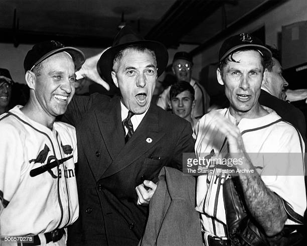 Left to Right Enos Slaughter Ford Frick and Harry Brecheen pose for the camera while celebrating in the Cardinals locker room after thier game 7...
