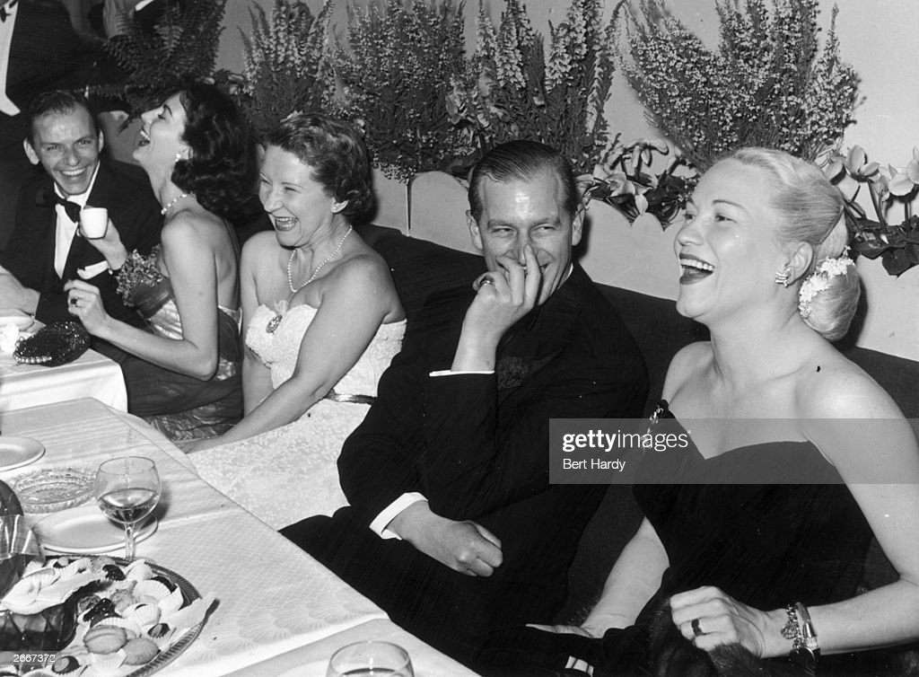 Left to right, Frank Sinatra, Ava Gardner (1922 - 1990), Mrs C.J. Latta, <a gi-track='captionPersonalityLinkClicked' href=/galleries/search?phrase=Prince+Philip&family=editorial&specificpeople=92394 ng-click='$event.stopPropagation()'>Prince Philip</a>, Duke of Edinburgh and American opera singer Dorothy Kirsten enjoying an after dinner joke at a Variety Club of Great Britain benefit for the National Playing Fields Association, at the Empress Club, London, 29th December 1951. Mrs Latta is the wife of a co-founder of the Variety Club of Great Britain.