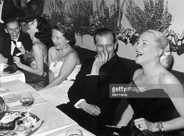 Left to right Frank Sinatra Ava Gardner Mrs CJ Latta Prince Philip Duke of Edinburgh and American opera singer Dorothy Kirsten enjoying an after...