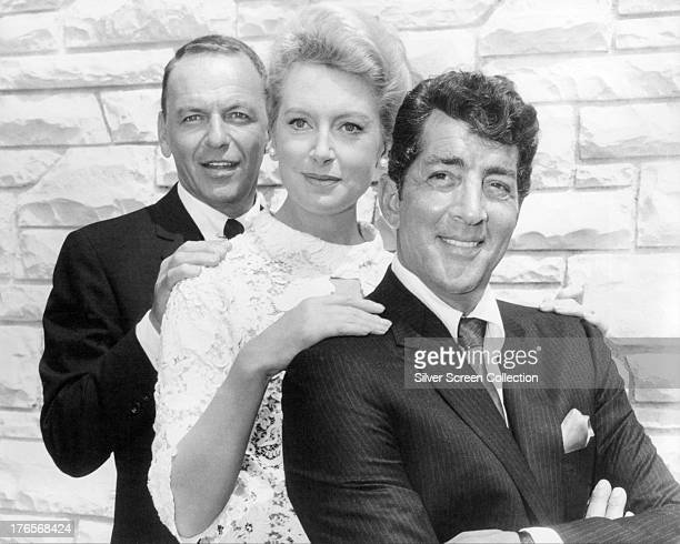 Frank Sinatra Deborah Kerr and Dean Martin in a promotional portrait for 'Marriage On The Rocks' directed by Jack Donohue 1965