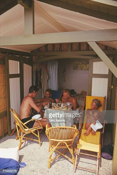 French actor Louis Jourdan Anne Buydens and her husband American actor Kirk Douglas and Jourdan's wife Quiquie dining together in a beach hut at the...