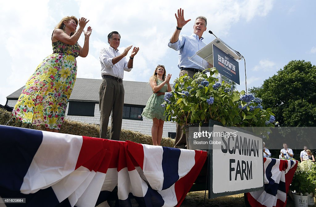 Left to right, Gail Huff, Mitt Romney and Arianna Brown applaud as Scott Brown addresses the crowd at Bittersweet Farm in Stratham, New Hampshire July 2, 2014.