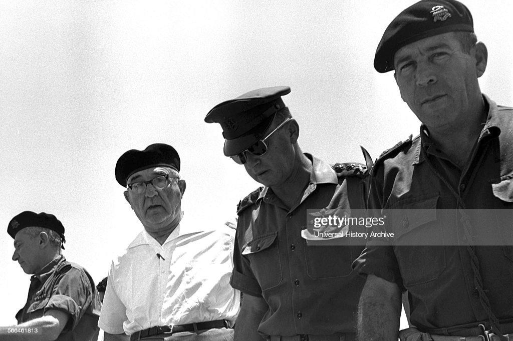 General Haim bar Lev Prime Minister Levi Eshkol Chief of staff General Yitzhak Rabin and Major General Israel tal visit positions in the Sinai...