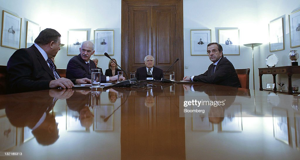 Left to right, George Karatzaferis, leader of the opposition LAOS party, <a gi-track='captionPersonalityLinkClicked' href=/galleries/search?phrase=George+Papandreou&family=editorial&specificpeople=212855 ng-click='$event.stopPropagation()'>George Papandreou</a>, Greece's prime minister, <a gi-track='captionPersonalityLinkClicked' href=/galleries/search?phrase=Karolos+Papoulias&family=editorial&specificpeople=743016 ng-click='$event.stopPropagation()'>Karolos Papoulias</a>, Greece's president, and Antonis Samaras, leader of the opposition New Democracy party, discuss the formation of a unity government at the Greek presidential palace in Athens, Greece, on Thursday, Nov. 10, 2011. Lucas Papademos, the former vice president of the European Central Bank, was chosen to lead a new Greek unity government, paving the way for a coalition charged with securing additional financing to avert the country's economic collapse. Photographer: Kostas Tsironis/Bloomberg via Getty Images