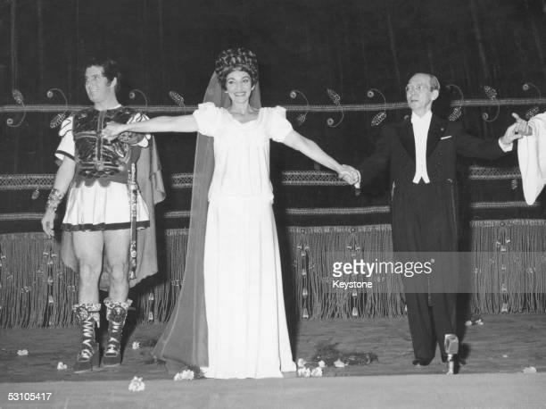 Italian baritone Ettore Bastianini American soprano Maria Callas and conductor Antonino Votto take their curtaincall after a performance of...