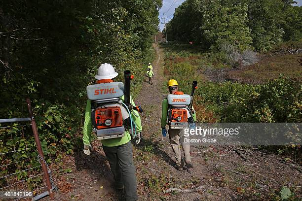 Left to right Jason Savoy and Ben Bray with Vegetation Control Services walk the trail to an area that will be sprayed After years of halting use of...