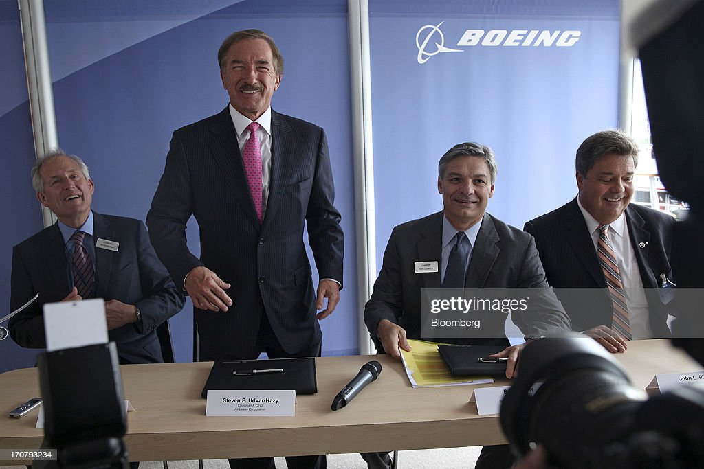 Left to right, Jim McNerney, chief executive officer of Boeing Co., Steven Udvar-Hazy, chief executive officer of Air Lease Corp., <a gi-track='captionPersonalityLinkClicked' href=/galleries/search?phrase=Ray+Conner&family=editorial&specificpeople=7660065 ng-click='$event.stopPropagation()'>Ray Conner</a>, chief executive officer of Boeing Commercial Airplanes, and John Plueger, chief operating officer of Air Lease Corp., attend a news conference on the second day of the Paris Air Show in Paris, France, on Tuesday, June 18, 2013. The 50th International Paris Air Show is the world's largest aviation and space industry show, and takes place at Le Bourget airport June 17-23. Photographer: Balint Porneczi/Bloomberg via Getty Images
