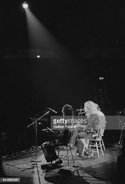 Jimmy Page Robert Plant and John Paul Jones of British heavy rock group Led Zeppelin performing at Earl's Court London May 1975 The band were...