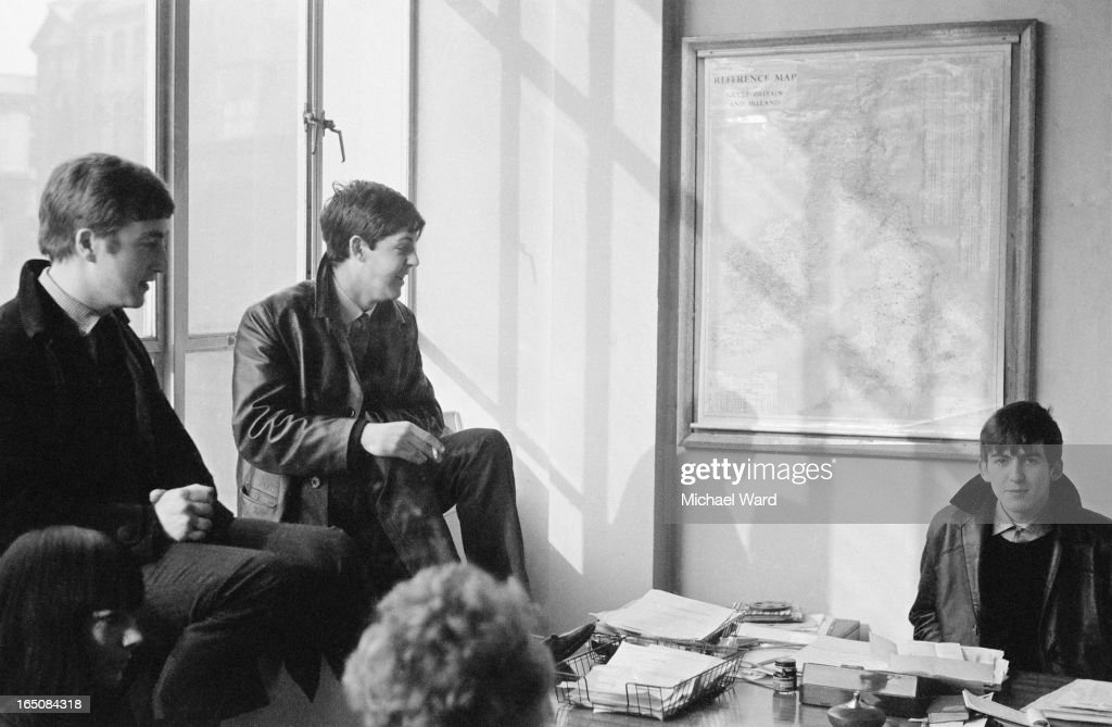 John Lennon (1940 - 1980), Paul McCartney and George Harrison (1943 - 2001) of The Beatles at the offices of Brian Epstein's NEMS Enterprises management company, Liverpool, 1st February 1963.