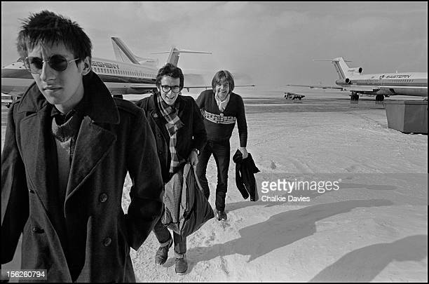 Keyboard player Steve Nieve and singersongwriters Elvis Costello and Nick Lowe arriving at Buffalo Niagara International Airport New York March 1978