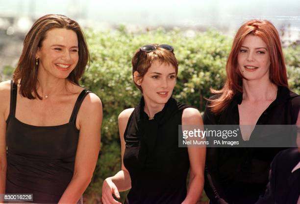 Lena Olin Winona Ryder and Chiara Mastroianni three members of the 51st Cannes Film Festival jury pose on the roof of the Palais des Festivals in...