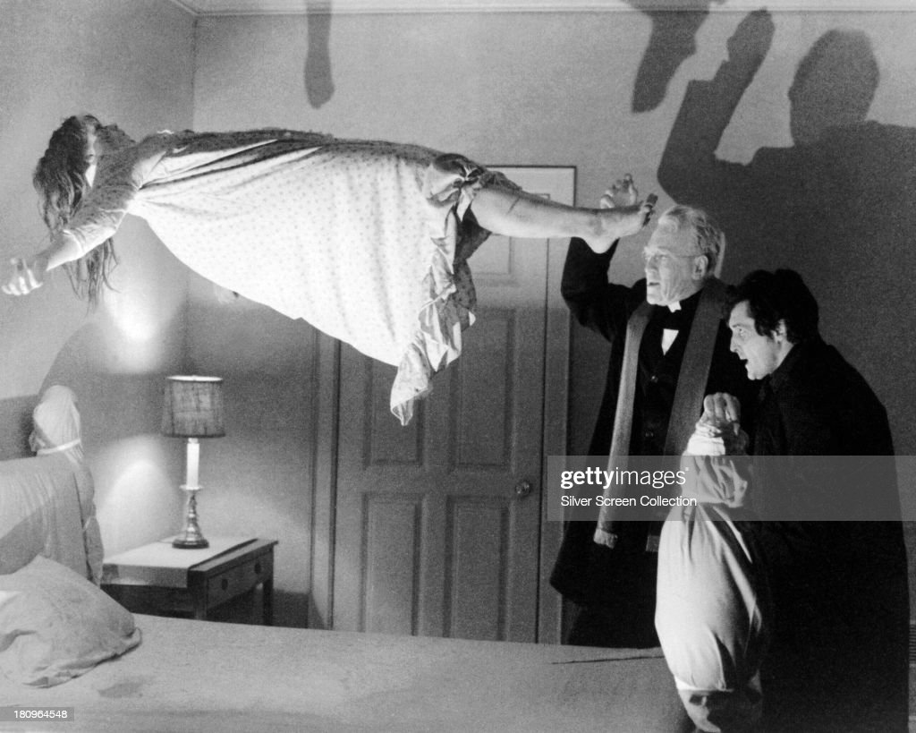 Linda Blair as Regan MacNeil Max von Sydow as Father Merrin and Jason Miller as Father Karras in 'The Exorcist' directed by William Friedkin 1973