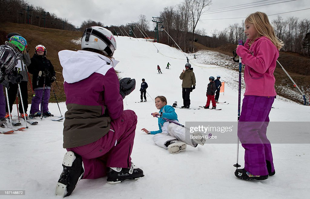Lindsay Bogar, 12, Rachel Shepard, 10, and Lexi Swartz, 9, play around during a ski day at Loon Mountain Resort in Lincoln, New Hampshire on November 24, 2012.